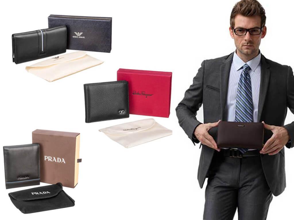 Мужские черные бумажники отличаются размерами, наличием и типом застежки, а также материалом