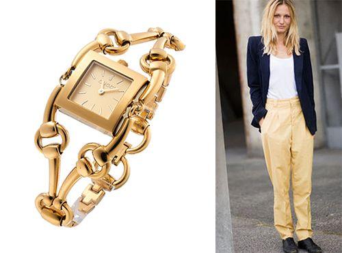 Женские часы Gucci с циферблатом золотистого цвета